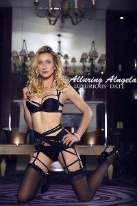 Mature blonde escort in black silk lingerie