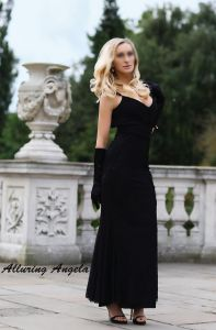 Mature blonde in black evening dress and gloves