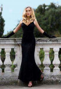 Mature blonde escort in black evening dress and gloves