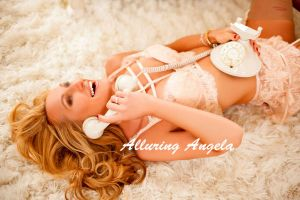 blonde Russian mature escort in nude lace lingerie with a vintage phone