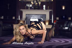 mature blonde in black silk lingerie and stilettos