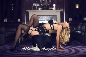 blonde milf escort in black lingerie and stilettoes